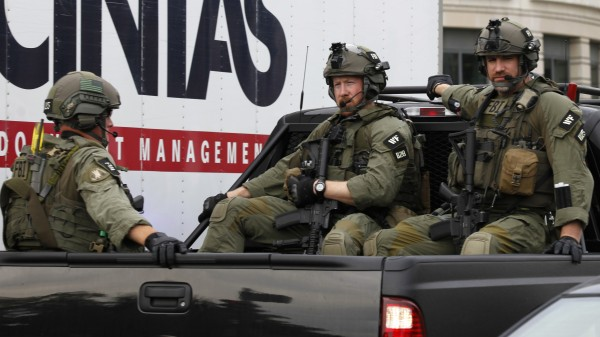 An FBI armed unit makes its way to the U.S. Capitol after a shooting in Washington on Thursday.