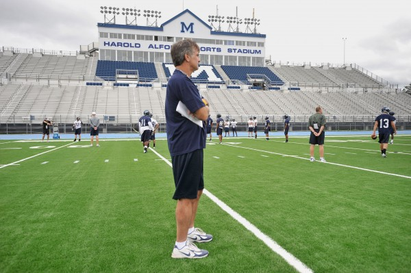 University of Maine football coach Jack Cosgrove stands on Morse Field's new FieldTurf surface at Alfond Sports Stadium in August 2008. The facility will have a new high-definition video scoreboard next fall.