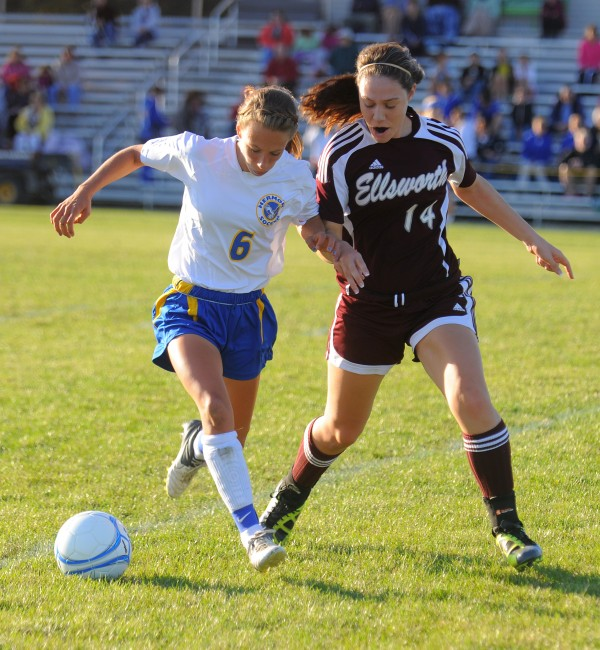 Hermon High School's Kaitlin Saulter (left) and Ellsworth High Scool's Emily Berry battle for the ball during a game last season. Saulter has helped lead the Hawks to an undefeated regular season and they begin the playoffs next Tuesday.