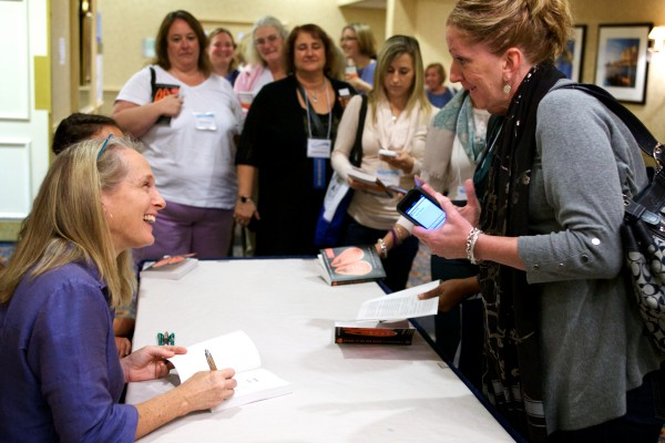 Piper Kerman, author of &quotOrange is the New Black,&quot signs her book in Portland at a Tuesday conference about women in prison.