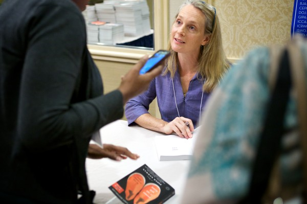 Piper Kerman, author of &quotOrange is the New Black,&quot talks with others at a Tuesday conference about women in prison.
