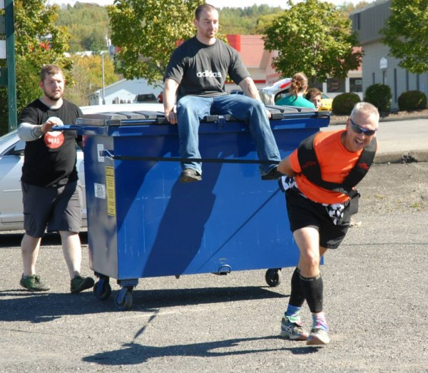 Among the various &quotpain stations&quot in this year's Aroostook Dirty Thirty was a session of towing a dumpster around the Mojo Sports parking lot under the direction of two torture volunteers. Pulling hard got racer Stephen Assante a second place finish this year.