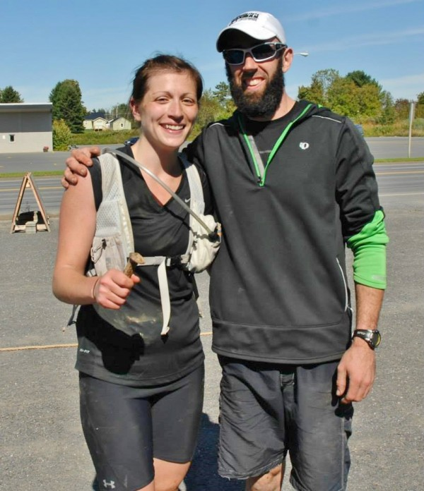 Aroostook Dirty Thirty organizer Kale Poland congratulates this year's first place finisher Lillian Porteus at the finish line.