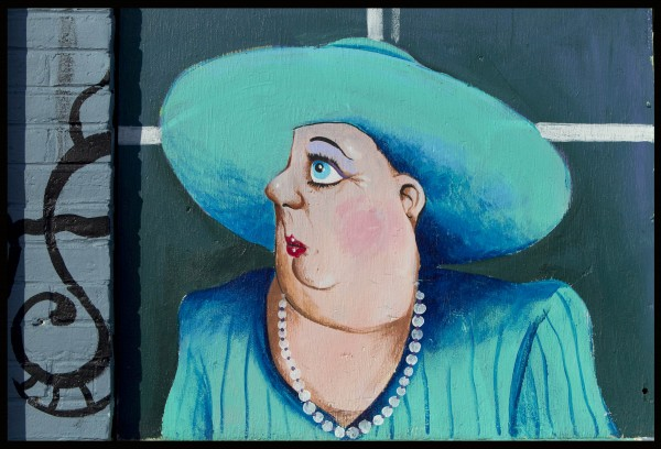 A woman dressed to travel in a mural at the Lewiston Pawn Shop.