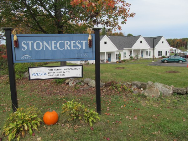 The second phase of Avesta Housing's subsidized Stonecrest development for seniors can be seen beyond the sign at the project driveway. The nonprofit hosted a harvest luncheon under an event tent at the site Friday to celebrate its opening this year.