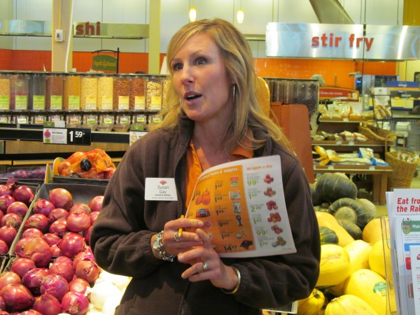 Susan Gay, a dietitian for the grocery store chain Hannaford, discusses the value -- and relatively affordability -- of fresh produce Thursday during a Cooking Matters program tour of the store on Forest Avenue in Portland. Cooking Matters, run in part by the Good Shepherd Food Bank, helps low-income Mainers learn how to prepare healthy meals inexpensively.