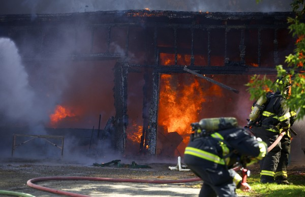 Fire crews fight a fire that destroyed a garage and damaged nearby homes on Hancock Street in Bangor around 2 p.m. Friday, Sept. 27.