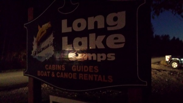 A sign marks the entry to Long Lake Camps in Princeton, where a shooting was reported Tuesday afternoon.