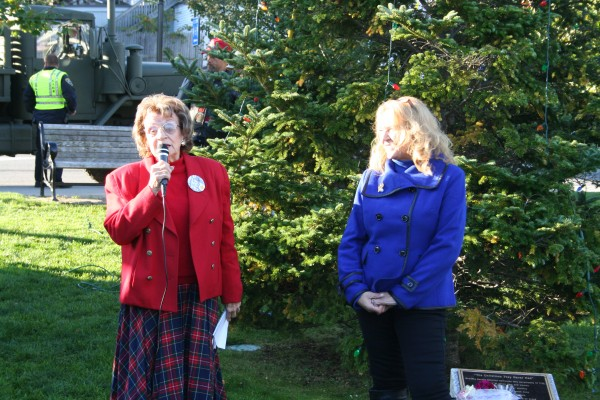 Edith Nowels (left) of Brielle, N.J. addresses gathering in Bar Harbor Sunday morning before Christmas lights were removed from a tree in a public park and transported to Columbia Falls.