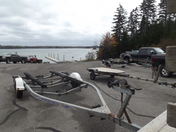 Trucks and boat trailers parked at Edmunds boat launch on Wednesday by fisherman; the boat launch provides immediate access to Whiting Bay and the waters of Cobscook Bay.