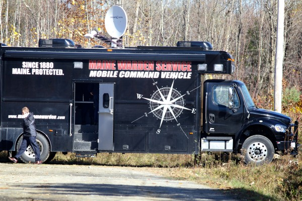 A law enforcement official talks on the phone near a Maine Warden Service vehicle off Hussey Hill Road in Oakland on Wednesday where the search for Ayla Reynolds continued.