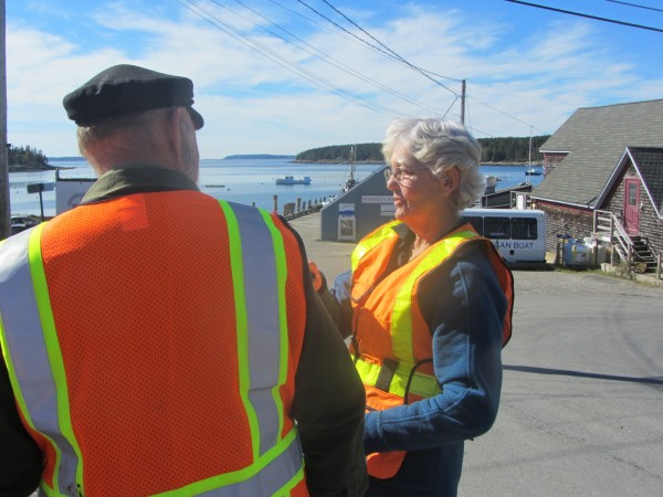 Knox County Sheriff Donna Dennison (right) talks with a group that includes Jim Barstow about ways to improve traffic and pedestrian safety in Port Clyde village.
