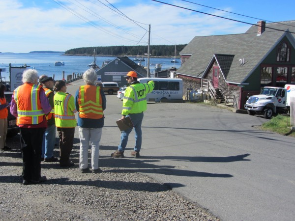 Maine Department of Transportation Regional Traffic Engineer Dave Allen (right) discusses Wednesday morning possible safety measures that could be taken in Port Clyde Village at the end of Route 131.