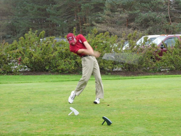 Rye Powell of Bangor High School drives the ball during Saturday's team golf state championships in Vassalboro.