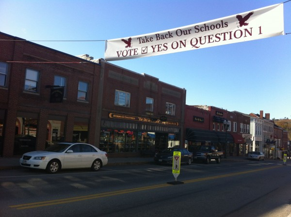 A sign across Main Street urged voters to vote to withdraw from RSU 24.