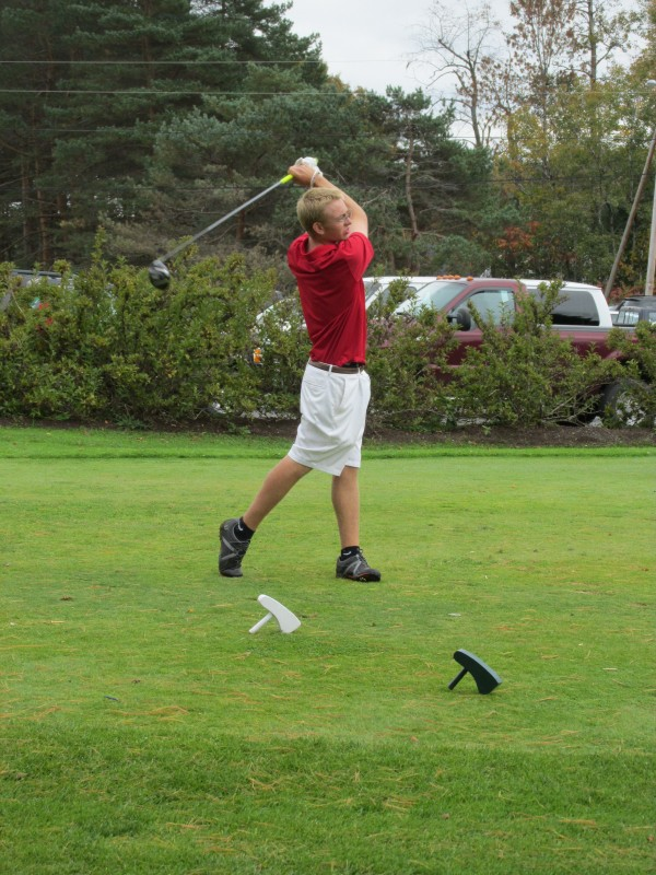 Daulton Wickenden of Camden Hills swings on the first tee of the Tomahawk Course during Saturday's Maine high school team golf state championships at Natanis Golf Course in Vassalboro. The Windjammers won the Class B title.