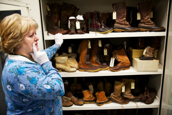 L.L. Bean Archivist Ruth Porter opens a climate controlled locker containing historic and iconic footwear from the company's past in Freeport Tuesday.
