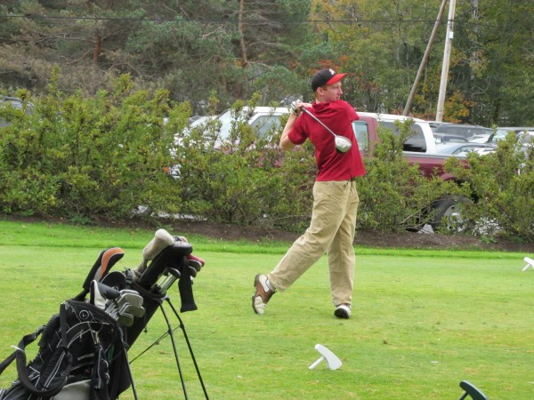 Liam Redding of Bangor High School follows the flight of his drive off the first tee during Saturday's Maine high school team golf state championships at Natanis Golf Course in Vassalboro.