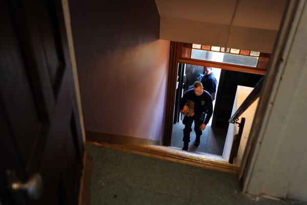Maine State Police evidence technicians enter the apartment building on Middle Street in Old Town where April Haskell was allegedly stabbed to death by her boyfriend Christopher Ouellette Wednesday evening.