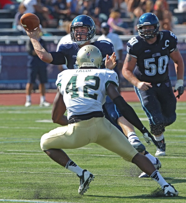 Villanova quarterback John Robertson (19) passes the ball before being hit by William and Mary's Ivan Tagoe (42) in the second quarter in Villanova, Pennsylvania, Saturday, October 5, 2013. Villanova beat William and Mary, 20-16.