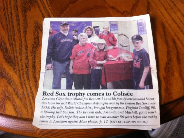 A news clipping from 2004 shows Virginia Tardiff, now 99, visiting the Red Sox World Series trophy in Lewiston with her family.