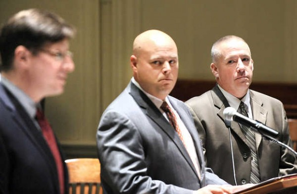 Michael Warbin, 44, of Franklin, Conn., right, and his lawyer, Jonathan Berry, center, listen to Deputy District Attorney Andrew Robinson, left, address Justice MaryGay Kennedy in Androscoggin Country Superior Court Thursday morning.  Warbin pleaded not guilty to a manslaughter charge in connection to a fatal shooting at the former DeCoster egg farm in Turner this past August.
