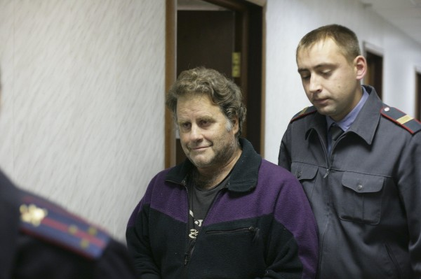 Greenpeace International captain Peter Willcox from the U.S. (front) is escorted at the Leninsky District Court Of Murmansk, Sept. 26, 2013, in this handout provided by Greenpeace. Russian President Vladimir Putin said on Wednesday that the activists had violated international law but signalled they should not face charges of piracy.
