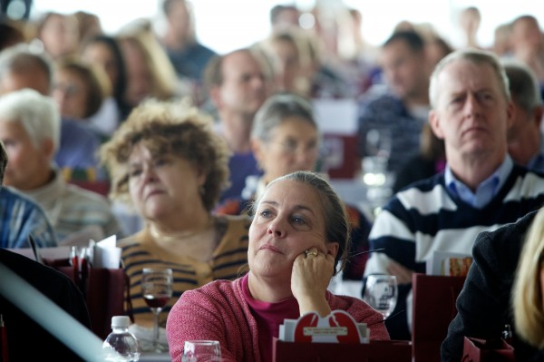 An audience of diners looks on at the Harvest on the Harbor lobster cooking contest Thursday in Portland.