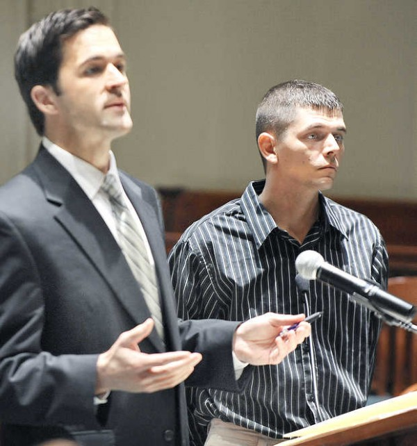 Matthew Libby, left, address Active-Retired Justice Robert Clifford in Androscoggin County Superior Court in Auburn Thursday morning representing his client, Adam J. Getchell, right.  Getchell is accused of making racist remarks and beating on the victim's car in a road rage incident in July.