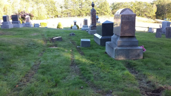 Tire tracks were left in the grass at the Monmouth Ridge Cemetery on Friday night, Sept. 27, 2013, reportedly after a mother and daughter got into a fight. The women, from Winthrop, may have caused an estimated $35,000 in damage.