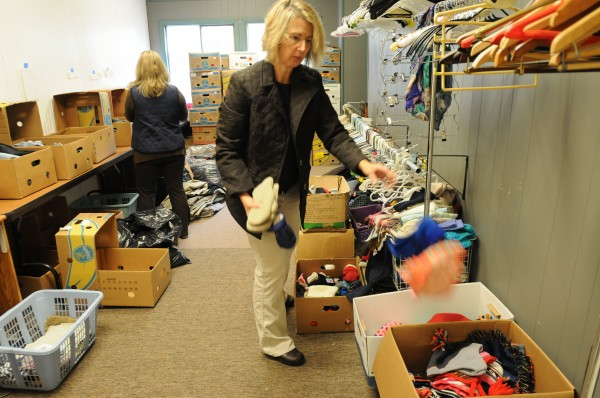 Cindy Pratt, right, and Sherry Molcan of Manna Ministries sort clothing at the new Home Store Thrift Shop in Bangor on Friday. Bill Rae is capitalizing on donations to Manna and wants to use cash earned from donations to support his programs at Manna.