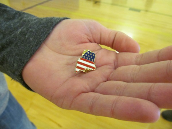 Gov. Paul LePage removed this pin from his lapel and gave it to 14-year-old Gabriel Brady, whose mother died during a domestic violence incident in January 2008, during an event on Thursday, October 24, 2013, in Augusta.