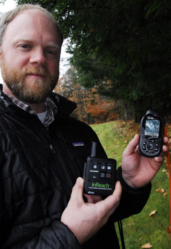 Chip Noble, product and design manager at DeLorme in Yarmouth, demonstrates the use of the company's inReach device in November 2011.