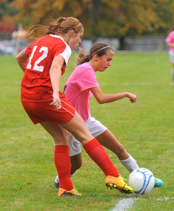 Dexter High School's Abbie Melvin (left) and Orono High School's Becky Lopez-Anido battle for the ball during the fist half of the game in Orono Wednesday.