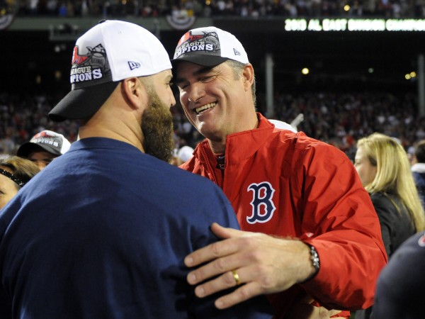 Sox manager John Farrell, right, congratulates first baseman Mike Napoli after defeating the Detroit Tigers to win the American League pennant at Fenway Park on Oct. 19.