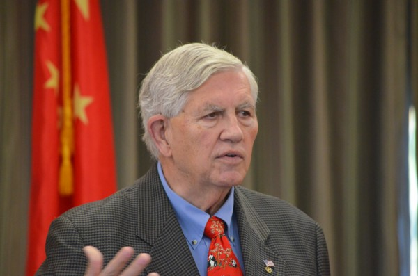 Bangor City Council Chairman Nelson Durgin addresses the crowd at the Maine Chinese Conference at the Dyke Center for Family Business at Husson University on Friday.