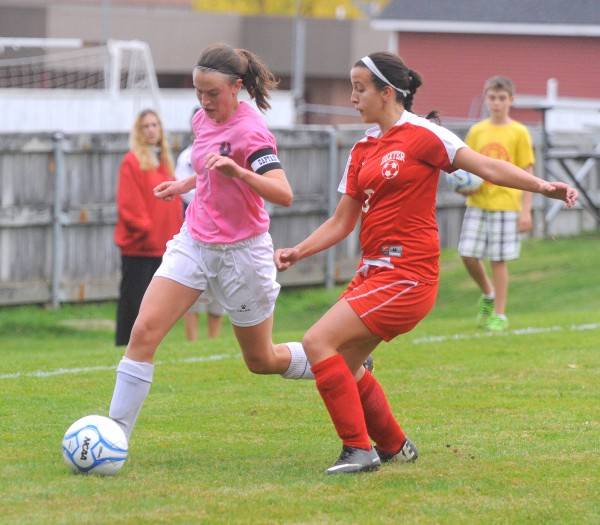 Orono High School's Hanna Renedo (left) and Dexter High School's Skyler Theodore battle for the ball during the fist half of the game in Orono Wednesday.