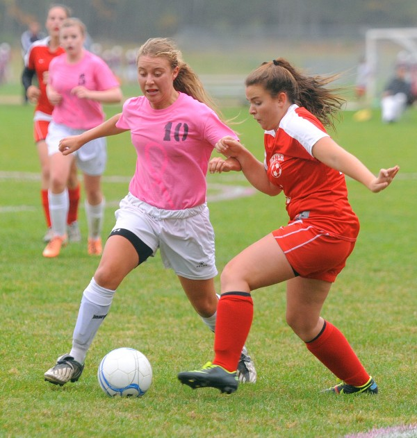 Orono High School's Dianna Tyutyunnyk (left) and Dexter High School's MacKenzie McKusick battle for the ball during the fist half of the game in Orono Wednesday.