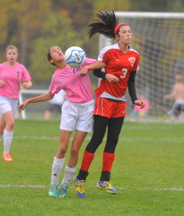 Orono High School's Becky Lopez-Anido (left) and Dexter High School's Christine May goa up for a header during the fist half of the game in Orono Wednesday.