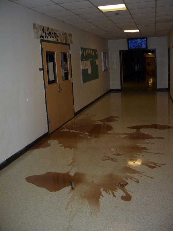 Lobster bait covers the floor in front of the library at Mount Desert Island High School. An estimated 25 gallons of fish pieces and guts were spread early Friday morning in the hallways causing the school to be closed for the day. Five seniors were charged with burglary and aggravated criminal mischief in connection with the vandalism.