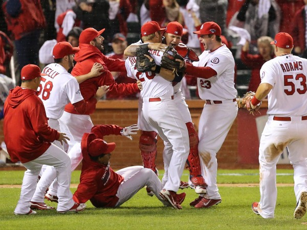 The St. Louis Cardinals celebrate a 9-0 win against the Los Angeles Dodgers in Game 6 of the National League Championship Series at Busch Stadium in St. Louis Friday night. The win advances the Cards to the World Series.