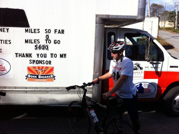 Rob Jones stands in front of the truck that will carry supplies for his cross-country  bike ride. Jones' younger brother will drive the truck, following behind him the whole way.