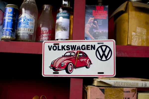 An old license plate hangs on a shelf at The Beetle Shop in Belfast. The shop has seen a rise in the amount of VW camper vans being serviced and repaired over the last two years.