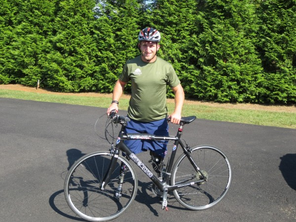 Rob Jones is pictured here with his bike, which he was told he would not be able to ride after he lost both his legs to an improvised explosive device in Afghanistan. Now he is on a bike ride from Bar Harbor to San Diego.