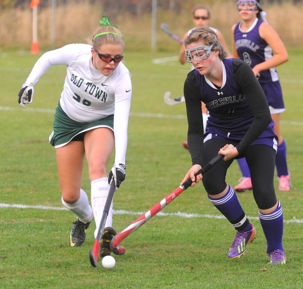 Old Town's Sarah Plunkett (left) and Waterville's Olivia Lopes battle for the ball during the first half of the game in Old Town Wednesday.