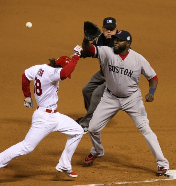 St. Louis Cardinals Pete Kozma is out on a close play at first with Boston Red Sox David Ortiz making the catch during Game 5 of the World Series at Busch Stadium in St. Louis on Monday.