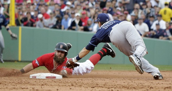 Boston's Mike Napoli reaches the bag on a double, despite a close tag by the Tampa Bay's Ben Zobrist at second base, in the fifth inning of Game 1 of their American League Divisional Series Friday at Fenway Park in Boston.