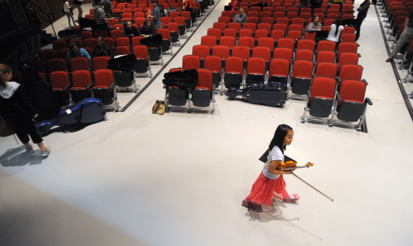 Sophie Kahn walks off the stage after the rehersal of the Prelude String Orchestra that is the musical home to the youngest players of the Bangor Symphony Youth Orchestras.