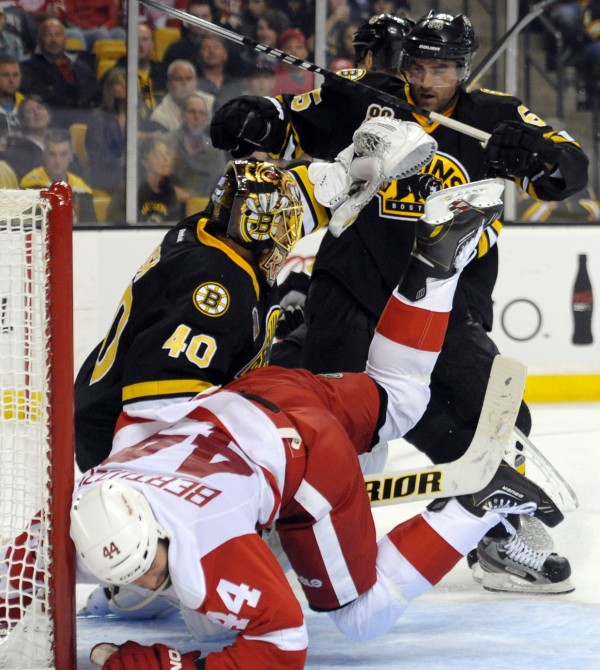 Detroit Red Wings right wing Todd Bertuzzi (44) collides with Boston Bruins goalie Tuukka Rask (40) after being pushed by Bruins defenseman Johhny Boychuck (55) during the third period at TD Banknorth Garden in Boston Monday.