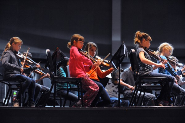 Musicians in the Prelude String Orchestra play during the rehearsal at the Bangor High School.